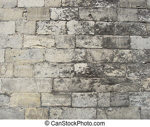 very old worn wall with large stones