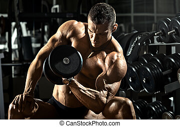 bodybuilder - very power athletic guy bodybuilder , execute...