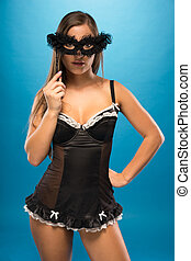 Very Sexy Woman in Black Holding Fashioned Mask