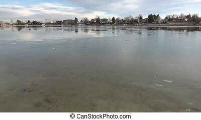 Very Thin Ice on Lake - A thin sheen of ice on residential...