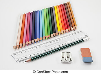 Very tidy basic school supplies on a white background