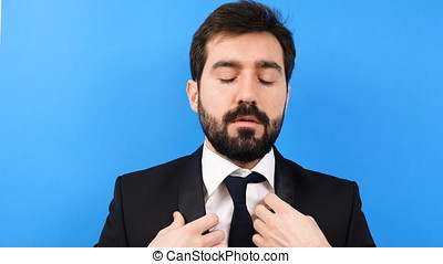 Very tired and stressed businessman starts to bite his tie