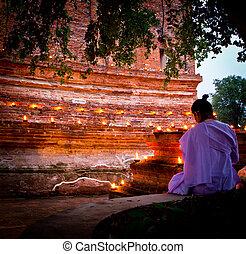 Vesak Bucha candle lit Old Thai temple in ayutthaya thailand