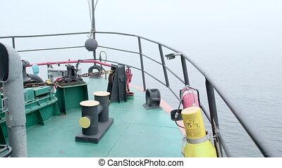 Vessel prow in the misty sea