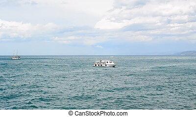 vessel (ship) on the azure sea wave