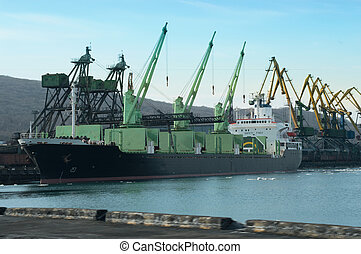 Vessel Under Loading - Vessel in port under loading of coal...