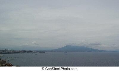 Vesuvius Volcano in the clouds hat in the Bay of Naples