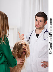 Vet giving medical recommendations