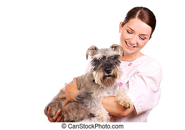 Vet holding a dog and smiling - A pretty veterinarian...