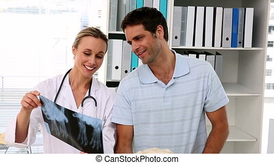 Vet showing xray to labradors owner - Vet showing xray to...