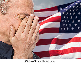 Veteran. Portrait of an elderly man with face closed by hand...
