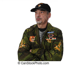 Veteran Salutes - Vietnam veteran with arms folded on white