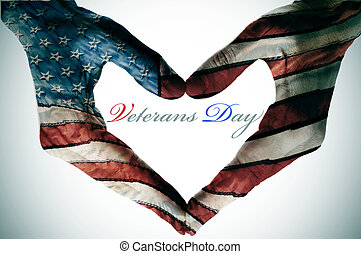 veterans day written in the blank space of a heart sign made...