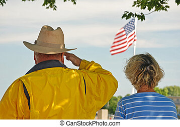 Veteran\'s Salute - War veteran saluting the American flag.