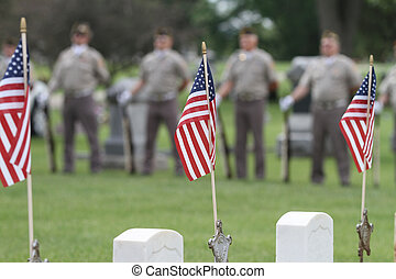 Memorial Day - Veterans stand behind American flags at...