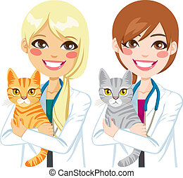 Two different beautiful young female veterinarian hugging cute kitty cat