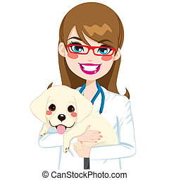 Beautiful young female veterinarian hugging cute little labrador puppy