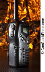 VHF walkie talkie with orange behind - Walkie-talkie for the...