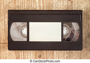 VHS video tape cassette on wooden background