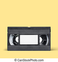 VHS video tape cassette on yellow background