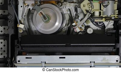 Video cassette player interior mechanism, ejecting tape