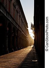 Via Zamboni in University district of Bologna at warm autumn...
