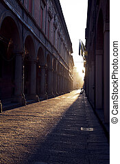 Via Zamboni in University district of Bologna at sunset -...