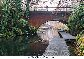 Viaduct with a pier in the water, beautiful river landscape, The park of Hilversum, The Netherlands