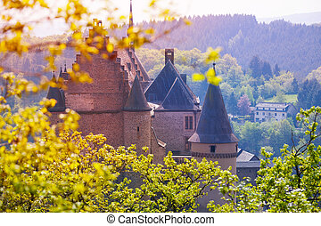 Vianden castle in Luxembourg through spring fresh leaves of ...