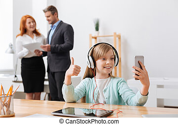 Vibrant active child capturing the moment in the office