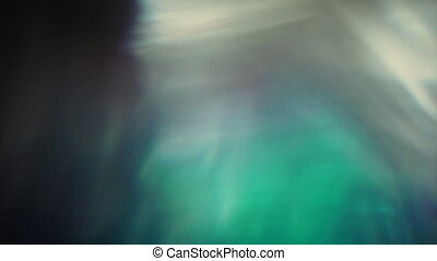 Vibrant blurred light leaks shining chaotic in space....