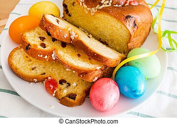 Vibrant color holiday background. Still life with Easter eggs and traditional cake