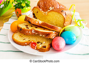 Vibrant color holiday background with Still life of Easter eggs and traditional holiday cake