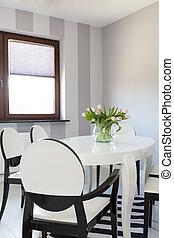 Vibrant cottage - White table - Vibrant cottage - Closeup of...
