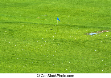 Vibrant golf course and target flag