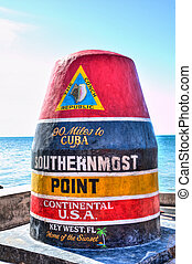 Vibrant HDR image of the iconic Key West southernmost point marker in the Continental USA, indicating 90 miles to Cuba.
