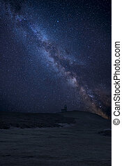 Vibrant Milky Way composite image over landscape of Belle Tout lighthouse on South Downs National Park