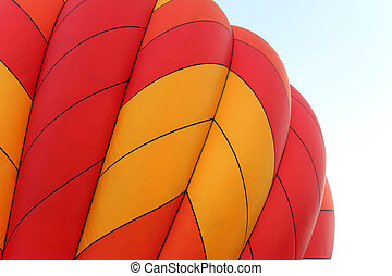 vibrant orange and yellow hot air balloon