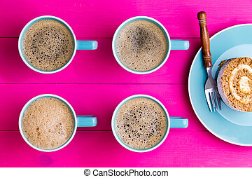 Vibrant overhead image of coffee and cake