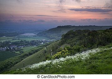 Vibrant sunrise over countryside landscape