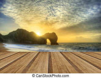 Vibrant sunrise over ocean with rock stack in foreground with wo