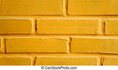 Vibrant yellow brick wall as a background