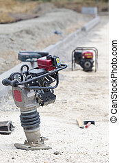 Vibrating plate machine at construction site