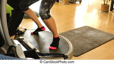 vibration plate with instructor - Slow motion half body of a...