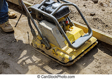 Vibratory plate compactor tool at construction compacting ...