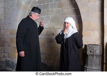 Vicar reprimand - Priest giving a young novice a reprimand