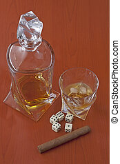 Whisky, cigar, dice and cards over wooden background
