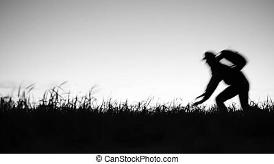 Victim escapes from the maniac murderer. Silhouette of a Man...