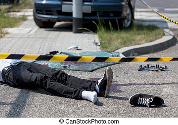 Victim of car crash - Horizontal view of male victim of car...