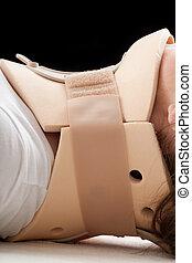 Victim of car crash in cervical collar